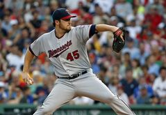 Minnesota Twins starting pitcher Phil Hughes fires one in against the Boston Red Sox in the third inning of a baseball game at Fenway Park in Boston, Tuesday, June 17, 2014. (AP Photo/Elise Amendola)
