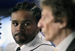 New Detroit Tigers first baseman Prince Fielder looks towards team owner Mike Ilitch after being formally introduced as a member of the team to reporters during a baseball news conference at Comerica Park in Detroit, Thursday, Jan. 26, 2012. (AP Photo/Carlos Osorio)