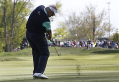Colin Montgomerie hits from the fairway on the 16th hole during the third round of the 75th Senior PGA Championship golf tournament at Harbor Shores Golf Club in Benton Harbor, Mich., Saturday, May 24, 2014. (AP Photo/Paul Sancya)