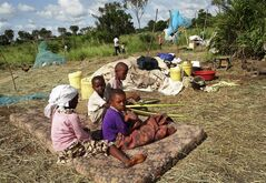 Children displaced from their village by the recent attacks sit on a mattress next to their parents' belongings, at the Kitale-Mavuno Internally Displaced Persons camp where hundreds of residents from the villages of Kaisari, Pangani and Poromoko have taken refuge, near Mpeketoni on the north coast of Kenya Thursday, June 19, 2014. Kenya's top opposition leader Raila Odinga said Wednesday that a statement by the country's president Uhuru Kenyatta that local political networks were responsible for two days of killings that left 60 people dead, and that they were not carried out by the Somali militant group al-Shabab, trivialized the massacre and went against the conclusions of security experts and foreign governments. (AP Photo)