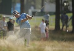 Erik Compton hits from the natural area on the 12th hole during the third round of the U.S. Open golf tournament in Pinehurst, N.C., Saturday, June 14, 2014. (AP Photo/Charlie Riedel)