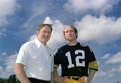 File- This Dec. 1975, file photo shows Pittsburgh Steelers head coach Chuck Noll, left, and quarterback Terry Bradshaw. Noll, the Hall of Fame coach who won a record four Super Bowl titles with the Pittsburgh Steelers, died Friday, June 13, 2014, at his home. He was 82. The Allegheny County Medical Examiner said Noll died of natural causes. (AP Photo/File)