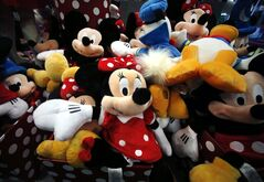 This Jan. 31, 2014 photo shows plush Disney characters piled up in a display at a Disney Store in Saugus, Mass. Disney reports quarterly earnings on Tuesday, May 6, 2014. (AP Photo/Elise Amendola)
