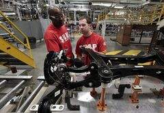 In this March 14, 2014 photo, assembly line workers build a 2015 Chrysler 200 automobile at the Sterling Heights Assembly Plant in Sterling Heights, Mich. The Federal Reserve releases industrial production for June 2014 on Wednesday, July 16, 2014. (AP Photo/Paul Sancya)