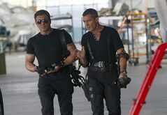 This image released by Lionsgate shows Sylvester Stallone, left, and Antonio Banderas in a scene from