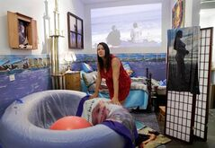Brooklyn-based performance artist Marni Kotak, who plans to give birth to her first child in front of a public audience at the Microscope Gallery in the Bushwick section of Brooklyn, is shown leaning on a birthing pool at the gallery, which has been converted into a birthing room, in New York, Monday, Oct. 17, 2011. The birth will be assisted by a midwife. (AP Photo/Kathy Willens)
