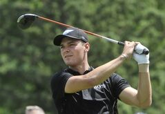 Martin Kaymer of Germany watches his drive on the third hole, during the first round of the Bridgestone Invitational golf tournament, Thursday, July 31, 2014, in Akron, Ohio. (AP Photo/Phil Long)