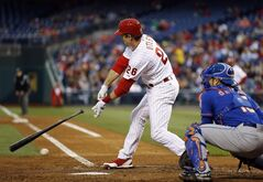 Philadelphia Phillies' Chase Utley loses his bat as he strikes out against New York Mets starting pitcher Zack Wheeler during the third inning of a baseball game, Thursday, May 29, 2014, in Philadelphia. At right is catcher Travis d'Arnaud. (AP Photo/Matt Slocum)