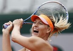 Russia's Maria Sharapova returns the ball to Australia's Samantha Stosur during their fourth round match of the French Open tennis tournament at the Roland Garros stadium, in Paris, France, Sunday, June 1, 2014. (AP Photo/Darko Vojinovic)