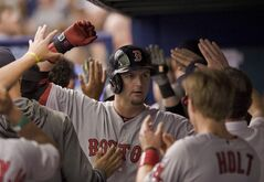 Boston Red Sox players greet A.J. Pierzynski, center, in the dugout after his three-run homer off Tampa Bay Rays starter David Price during the first inning of a baseball game Saturday, May 24, 2014 in St. Petersburg, Fla. (AP Photo/Steve Nesius)