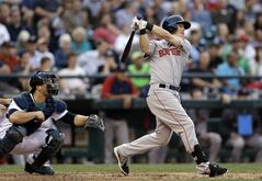 Boston Red Sox's Brock Holt watches his two-run home run in front of Seattle Mariners catcher Mike Zunino during the fourth inning of a baseball game Tuesday, June 24, 2014, in Seattle. (AP Photo/Elaine Thompson)