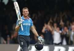 England's Jos Butler celebrates scoring 100 runs not out against Sri Lanka during their One Day International cricket match at Lord's cricket ground in London, Saturday, May 31, 2014. (AP Photo/Alastair Grant)