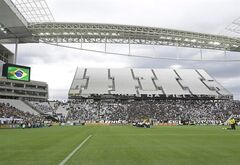 Corinthians's and Botafogo players listen to the national anthem prior to a Brazilian soccer league match at the Itaquerao, the stadium that will host the World Cup opener match between Brazil and Croatia on June 12, in Sao Paulo, Brazil, Sunday, June 1, 2014. (AP Photo/Andre Penner)