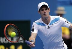 Andy Murray of Britain makes a forehand return to Stephane Robert of France during their fourth round match at the Australian Open tennis championship in Melbourne, Australia, Monday, Jan. 20, 2014.(AP Photo/Rick Rycroft)