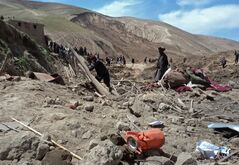 Afghans search for survivors after Friday's landslide buried Abi-Barik village in Badakhshan province, northeastern Afghanistan, Saturday, May 3, 2014. Afghan rescuers and hundreds of volunteers armed with shovels rushed on Saturday to help villagers hit by a massive landslide in the remote northeast a day earlier, officials said, while fears of a new torrent of mud and earth complicated rescue efforts. (AP Photo/Gulrahim Niazman)