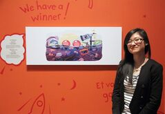 Cindy Tang, 17, winner of the Doodle 4 Google contest, poses with her work at the at the Royal Ontario Museum (ROM) in Toronto on Tuesday February 25, 2014. THE CANADIAN PRESS/Angela Hennessy