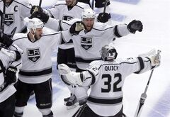 Los Angeles Kings goalie Jonathan Quick (32) celebrates with his teammates after the Kings defeated Chicago Blackhawks 5-4 in the overtime period in Game 7 of the Western Conference finals in the NHL hockey Stanley Cup playoffs Sunday, June 1, 2014, in Chicago. (AP Photo/Charles Rex Arbogast)