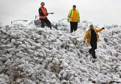 Workers at the Kapyong Barracks in Winnipeg prepare more than 600,000 sandbags, which will be sent west to help fight the flood on the Assiniboine River.