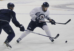 Alex Burmistrov, at Friday's informal workout, wants to play centre.