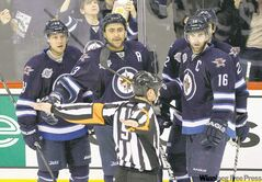 Winnipeg's Kyle Wellwood, Dustin Byfuglien, Chris Thorburn and Andrew Ladd (from left) dispute a disallowed second-period goal.