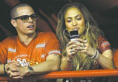 Jennifer Lopez, right, and Casper Smart watch carnival parades at the Sambadrome in Rio de Janeiro, Brazil.