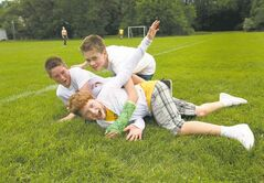 They're going into Grade 8, but boys will be boys. Griffin, Jessie and Avery play fight on the last day of school.