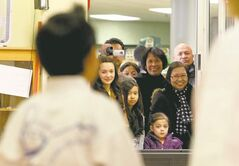 Family members (above) watch as six-year-old Anthony Contreras (left) is tested for his poom, or junior black belt in taekwondo, at Choi's Taekwondo in Garden City Shopping Centre. Receiving a poom is a very rare feat for someone so young.