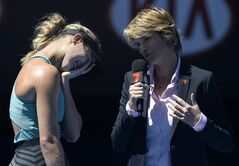Eugenie Bouchard of Canada reacts to a question from with television reporter Sam Smith during a post match interview following her quarterfinal win over Ana Ivanovic of Serbia at the Australian Open tennis championship in Melbourne, Australia, Tuesday, Jan. 21, 2014. (AP Photo/Andrew Brownbill)
