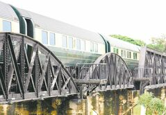 The Orient Express going over a bridge.
