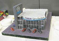 This cake was a perfect model of the new Gerry Gordon Mazda store.