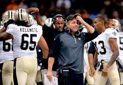 New Orleans Saints head coach Sean Payton reacts on the sideline after a touchdown in the second half of a NFL preseason football game against the Tennessee Titans in New Orleans, Friday, Aug. 15, 2014.