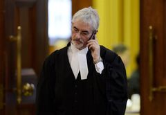 Lawyer Steven Shrybman speaks on the phone during a short recess of Federal Court during the first day of hearings challenging the outcomes of the last federal election in six closely contested ridings, Monday, December 10, 2012. THE CANADIAN PRESS/Adrian Wyld