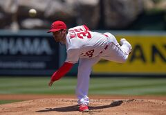 Los Angeles Angels starting pitcher C.J. Wilson throws to the plate during the first inning of a baseball game, Sunday, June 8, 2014, in Anaheim, Calif. (AP Photo/Mark J. Terrill)