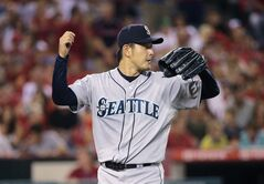 Seattle Mariners starting pitcher Hisashi Iwakuma, of Japan, walks off the field after the seventh inning of a baseball game against the Los Angeles Angels on Friday, July 18, 2014, in Anaheim, Calif. (AP Photo/Jae C. Hong)