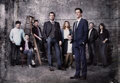 This undated publicity photo released by FOX shows Kevin Bacon, front right, as former FBI agent Ryan Hardy, who is called out of retirement to track down James Purefoy, (fourth from left) as Joe Carroll, in the new psychological thriller