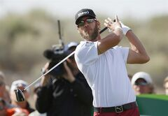 Graham, DeLaet, of Canada, lets go of his golf club after hitting his tee shot at the 15th hole during the final round of the Phoenix Open golf tournament on Sunday, Feb. 2, 2014, in Scottsdale, Ariz. (AP Photo/Ross D. Franklin)