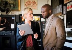This photo released by TNT shows Taye Diggs, right, and Kathleen Robertson, in a scene from