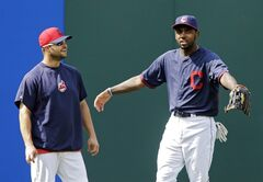 Cleveland Cavaliers All-Star guard Kyrie Irving, right, talks with Cleveland Indians' Nick Swisher during batting practice before a baseball game against the Los Angeles Angels Monday, June 16, 2014, in Cleveland. (AP Photo/Mark Duncan)