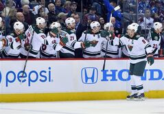 Minnesota Wild center Mikko Koivu (9) of Finland celebrates a goal against the Colorado Avalanche in the first period during Game 7 of an NHL hockey first-round playoff series on Wednesday, April 30, 2014, in Denver. (AP Photo/Jack Dempsey)