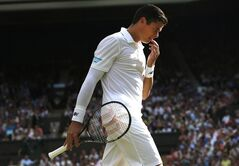 Milos Raonic of Canada walks back to the base line after losing a point to Roger Federer at Wimbledon, in London, on July 4, 2014. Raonic has had nearly a month to digest his Wimbledon semifinal loss to Roger Federer. But even after all that time, the sting still lingers. THE CANADIAN PRESS/AP, Pavel Golovkin