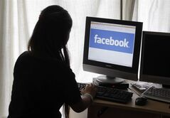 An unidentified 11-year-old girl looks at Facebook on her computer at her home in Palo Alto, Calif., on Monday, June 4, 2012. When it comes to the risk of heart disease in children, too many hours spent in front of TV, computer and video game screens is worse than other sedentary time like reading a book, a new Canadian study suggests. THE CANADIAN PRESS/AP-Paul Sakuma