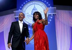 U.S. President Barack Obama and first lady Michelle Obama greet supporters during the Commander in Chief's Ball in Washington, D.C., Monday, celebrating the president's second inauguration.