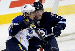 St. Louis Blues forward Alexander Steen (left) and Winnipeg Jets defenceman Jacob Trouba battle in front of the Jets net during first period NHL action at the MTS Centre in Winnipeg Tuesday.