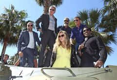 "FILE - In this May 18, 2014 file photo, from left, Jason Statham, Harrison Ford, Mel Gibson, Sylvester Stallone, Wesley Snipes and Ronda Rousey ride a tank during a photo call for The Expendables 3 at the 67th international film festival, Cannes, southern France. Rousey is constructing her escape hatch out of mixed martial arts, even if she's not planning to use it just yet. The UFC bantamweight champion has turned her celebrity and charisma into a budding career as an action film star. Many MMA fighters dream about it, but Rousey is actually doing it: With upcoming parts in ""The Expendables 3,"" the newest ""Fast and Furious"" chapter and the ""Entourage"" movie, she's seeking success outside the cage even while her fighting career is near its peak. (Photo by Joel Ryan/Invision/AP, File)"