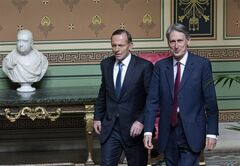British Foreign Minister Philip Hammond, right, walks with Australian Prime Minister Tony Abbott inside the Foreign and Commonwealth Office in London, Tuesday Aug. 12, 2014. Abbott is visiting London following a stop in Netherlands on Monday, to discuss evidence gathering in the Dutch-led criminal investigation into the downing of Malaysia Airlines Flight 17 in eastern Ukraine, which included Australian victims. (AP Photo / Justin Tallis, PA) UNITED KINGDOM OUT - NO SALES - NO ARCHIVES