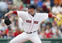 Boston Red Sox's Jon Lester pitches during the first inning of a baseball game against the Kansas City Royals in Boston, Sunday, July 20, 2014. (AP Photo/Michael Dwyer)