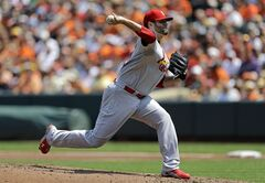 St. Louis Cardinals starting pitcher Lance Lynn throws to the Baltimore Orioles in the first inning of an interleague baseball game, Sunday, Aug. 10, 2014, in Baltimore. (AP Photo/Patrick Semansky)