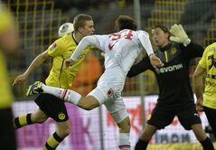 Augsburg's Ji Dong-won of South Korea scores with his head during the German Bundesliga soccer match between Borussia Dortmund and FC Augsburg in Dortmund, Germany, Saturday, Jan. 25, 2014. (AP Photo/Martin Meissner)
