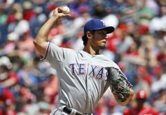 Texas Rangers starting pitcher Yu Darvish (11) throws during the fourth inning of a baseball game against the Washington Nationals at Nationals Park, Sunday, June 1, 2014, in Washington. (AP Photo/Alex Brandon)
