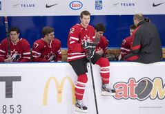 Team Canada forward Boone Jenner, centre, waits with teammates for the annual team picture during practice before the upcoming IIHF World Junior Championships in Ufa, Russia on Tuesday, Dec. 25, 2012. THE CANADIAN PRESS/Nathan Denette
